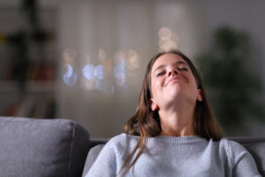 Satisfied homeowner relaxing breathing fresh air